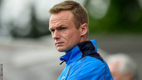 Wrexham boss Dean Keates watches his side play