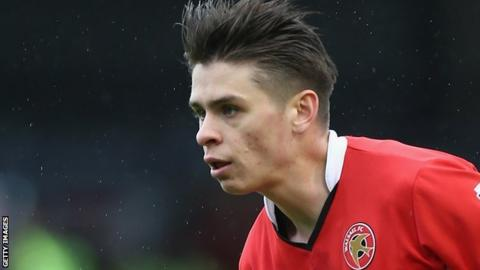 George Dobson: Walsall captain signs contract extension until 2021
