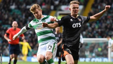 Celtic's Stuart Armstrong (left) battles for the ball against Kilmarnock's Mark O'Hara