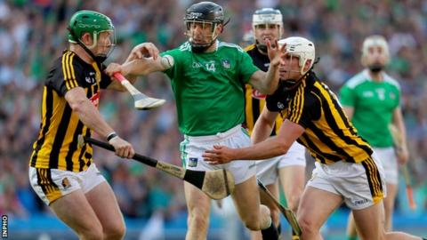 Limerick's Graeme Mulcahy is tackled by Kilkenny's Conor Browne and Paul Murphy