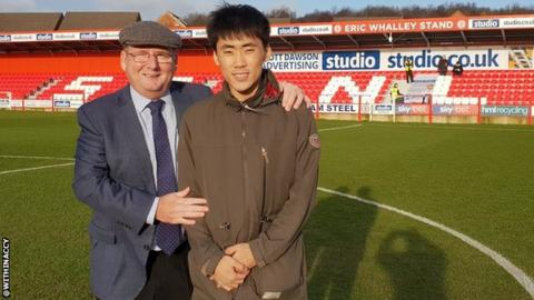 Accrington chairman Andy Holt with Korean fan Jung Min Yoo