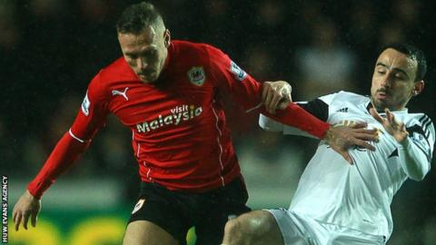 Craig Bellamy and Leon Britton compete against each other in February, 2014