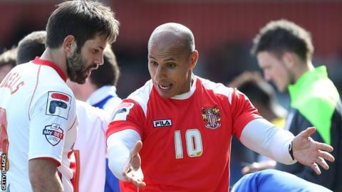 Dino Maamria (right) in discussion with a Stevenage player