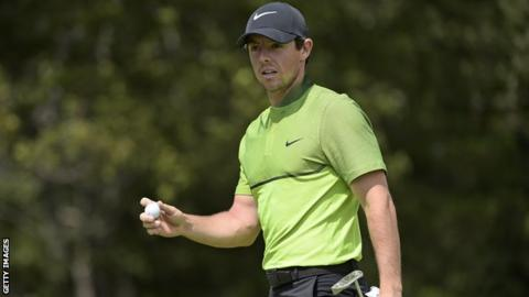 Rory McIlroy acknowledges applause after holing a putt at the 13th