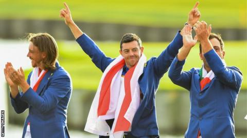 Rory McIlroy (centre) celebrates at the 2018 Ryder Cup, flanked by Europe team-mates Tommy Fleetwood (left) and Francesco Molinari (right)