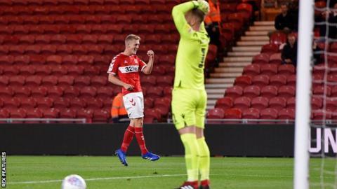George Saville celebrates his first-half goal against Bolton