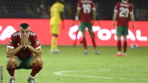 Morocco defender Romain Saiss shell shocked after his side were knocked out of Africa Cup of Nations in Egypt by Benin