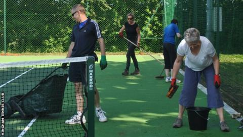 Volunteers keep the courts tidy at Hingham Tennis Club