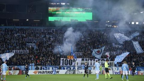 Malmo fans display banners during their first competitive match against Copenhagen in October