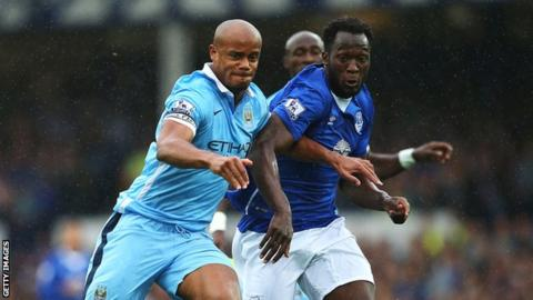 Vincent Kompany battles with Romelu Lukaku