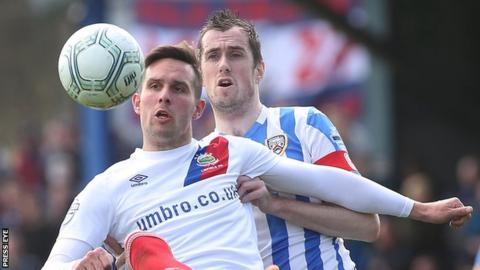 Andrew Waterworth and David Ogilby in action during Linfield's 5-1 league win over Coleraine last month