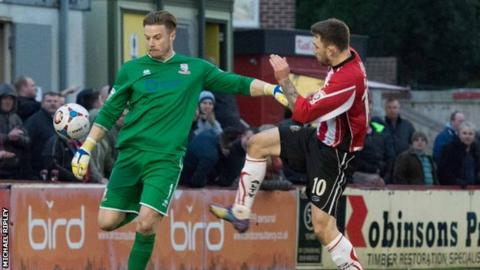 Lincoln keeper Paul Farman was caught short at the back