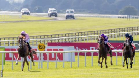 Padraig Beggy takes Sovereign well clear of Anthony Van Dyck (right) in the final furlong