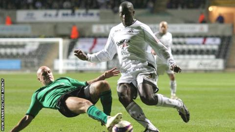 Swansea City's Kevin Austin is tackled by David Pipe of Bristol Rovers