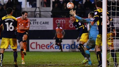 Danny Hylton (second left) equalises for Luton