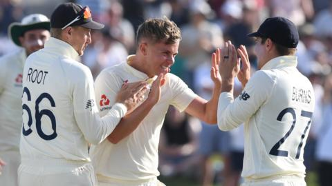 Sam Curran celebrates the key dismissal of Kane Williamson in the final hour of day two