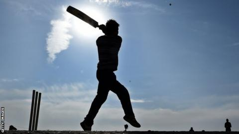 Cricket player in silhouette