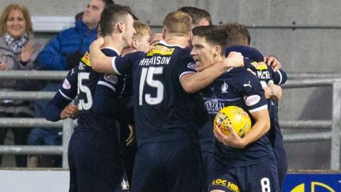 The Falkirk players celebrate Joe McKee's (not pictured) equaliser.