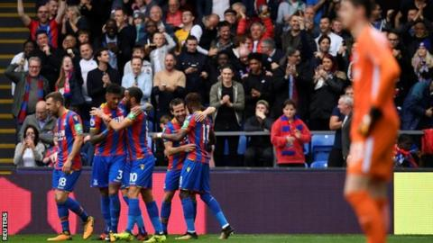 Crystal Palace celebrate scoring their first league goal of the season
