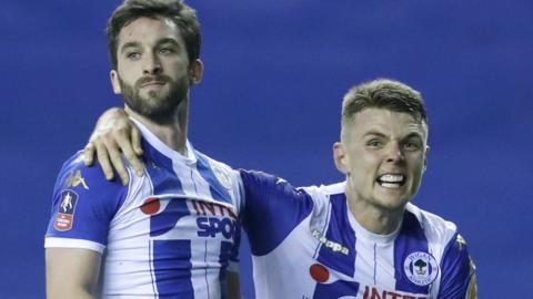 Will Grigg scores