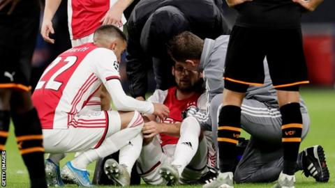 Daley Blind on the pitch after suffering from dizziness