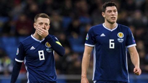 Scotland captain Callum McGregor and Scott McKenna are left disappointed