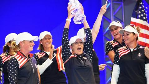 Cristie Kerr of the United States lifts the Solheim Cup aloft after their triumph