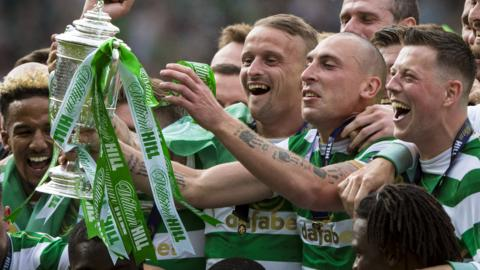 Celtic players celebrate with the Scottish Cup trophy