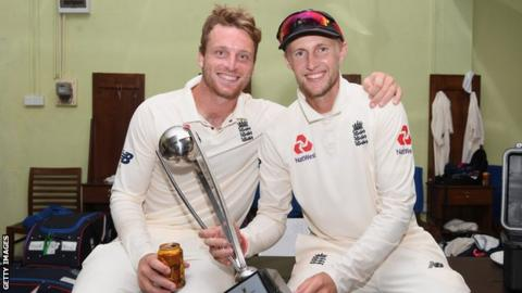 Vice-captain Jos Buttler and captain Joe Root celebrate England's series win in Sri Lanka