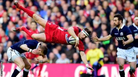Wales fly-half Dan Biggar takes a tumble against Scotland