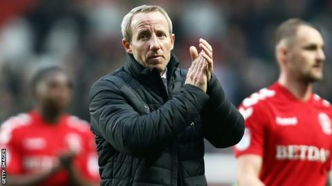 Charlton caretaker manager Lee Bowyer applauds fans after a game