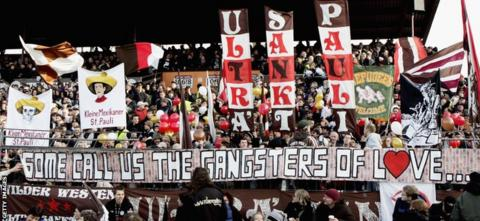 St Pauli fans display banners before a 2007 third tier match
