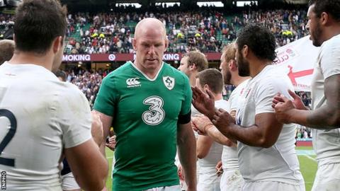 Dejected Ireland captain Paul O'Connell walks off the pitch at Twickenham after defeat by England