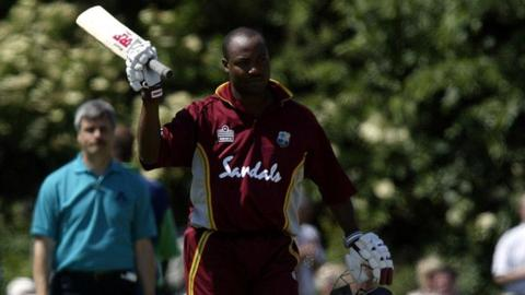 Brian Lara acknowledges applause from the Stormont crowd after hitting a century against Ireland in 2004