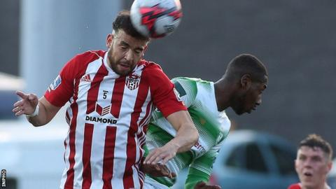Derry's Darren Cole battles with Shamrock Rovers' Daniel Carr