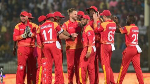 Zimbabwe cricket team celebrate taking a wicket