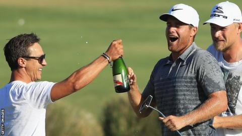 Portugal Masters winner Lucas Bjerregaard (right) celebrates with some champagne