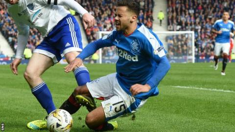 Harry Forrester reacts in pain after a heavy tackle during Rangers' win over Peterhead at Hampden