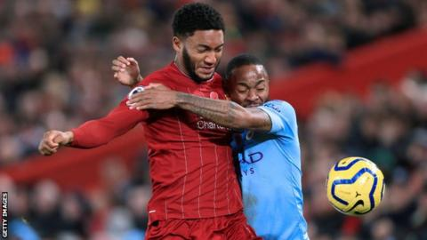 England's Joe Gomez and Raheem Sterling