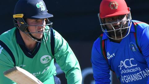 Ireland's Gary Wilson watches his shot against Afghanistan