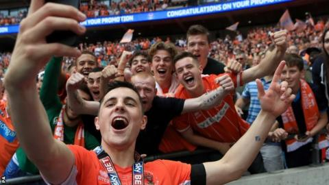Jordan Flores celebrates promotion as Blackpool player