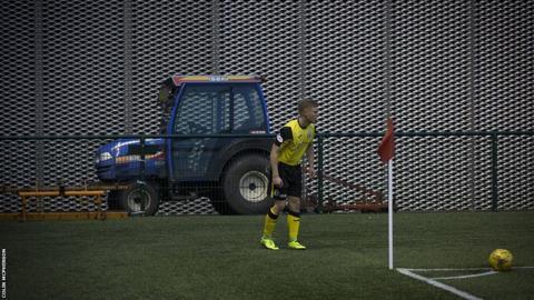 Edinburgh City midfielder Dean Cummings lines up a corner during the first-half.