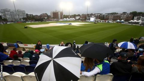 The umbrellas went up at Hove as the rain came down