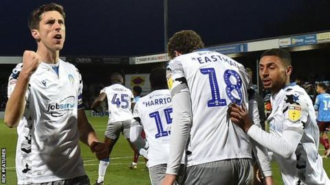 Luke Prosser of Colchester United scores the equalising goal 2-2 and celebrates