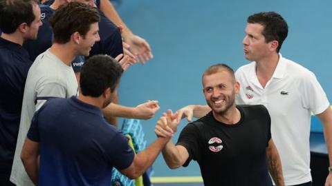 Dan Evans celebrates with the Great Britain team