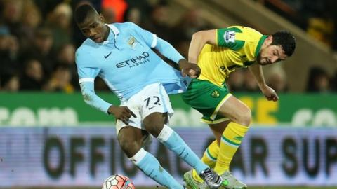 Norwich City's Graham Dorrans in action with Manchester City's Kelechi Iheanacho