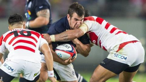 Scotland's Stuart McInally is held up by Japan
