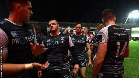 Ospreys dejected after a record defeat against Scarlets