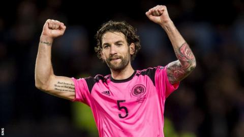 Charlie Mulgrew celebrates Scotland's 1-0 victory over Slovakia in their last World Cup qualifying campaign