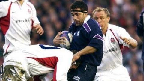 Budge Pountney is tackled playing for Scotland against England in 2002